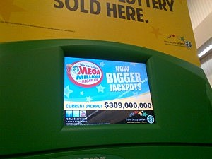 Tuesday's Mega Millions jackpot is displayed on a lottery machine at a Wawa in Toms River