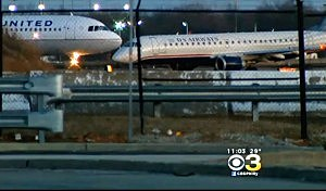 US Ariways plane on a runway at Philadelphia International Airport after a tire blew at takeoff