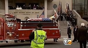 The body of firefighter Gregory Barnas is brought to a Wallington church