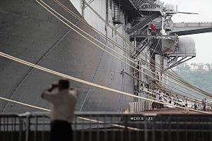 A man photographs the USS Wasp docked for Fleet Week festivities in 2012