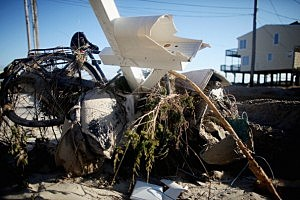 A pile of debris from Superstorm Sandy sits in front of a damaged home on in Beach Haven