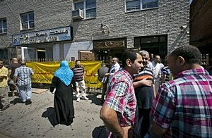 Visitors socialize after a Jumu'ah prayer service outside the Islamic Society of Bay Ridge and mosque in Brooklyn. The New York Police Department targeted the mosque as a part of a terrorism enterprise investigation