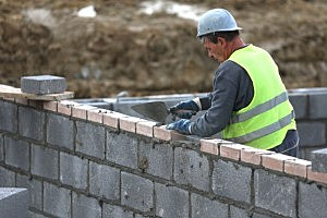 Construction workers continue to build new house