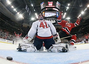 Ryan Carter #20 of the New Jersey Devils scores the game winning goal