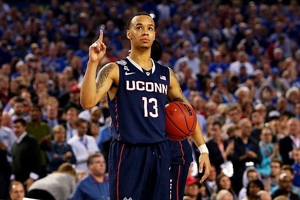 Shabazz Napier #13 of the Connecticut Huskies celebrates during the NCAA Men's Final Four Semifinal against the Florida Gators at AT&T Stadium on April 5, 2014 in Arlington, Texas