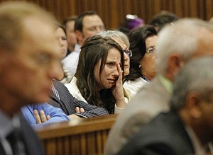 Aimee Pistorius is overcome with emotion as she listens to her brother Oscar's testimony in the Pretoria High Court