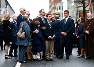 The family of Martin Richard including Bill Richard, along with Boston mayor Marty Walsh and other members of the victims families stand during a wreath-laying ceremony commemorating the one-year anniversary of the Boston Marathon bombings