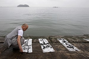 A South Korean monk performs during the buddhist ceremony for missing passengers of a sunken ferry at Jindo port in Jindo-gun, South Korea.
