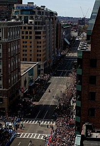 Meb Keflezighi of the United States runs down Boylston Street before finishing in first place to win the 2014 B.A.A. Boston Marathon