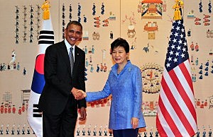 President Barack Obama (L) shakes hands with South Korean President Park Geun-Hye (R) before a meeting at the presidential Bule House in Seoul, South Korea
