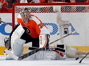 Steve Mason #35 of the Philadelphia Flyers makes the save against the New York Rangers