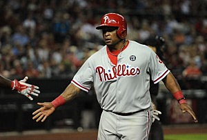 Marlon Byrd #3 of the Philadelphia Phillies celebrates a run against the Arizona Diamondbacks in the seventh inning