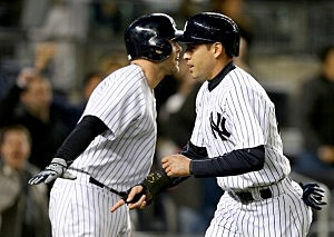 Jacoby Ellsbury #22 of the New York Yankees celebrates with teammate Brian McCann #34 after Ellsbury scored on a wild pitch in the eighth inning against the Los Angeles Angels