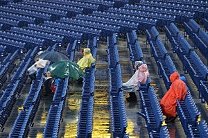 Fans sit through a rain delay before the game between the New York Mets and Philadelphia Phillies at Citizens Bank Park