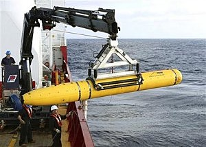 An autonomous underwater vehicle is prepared to be deployed from ADV Ocean Shield in the search of the missing Malaysia Airlines Flight 370 in the southern Indian Ocean. (