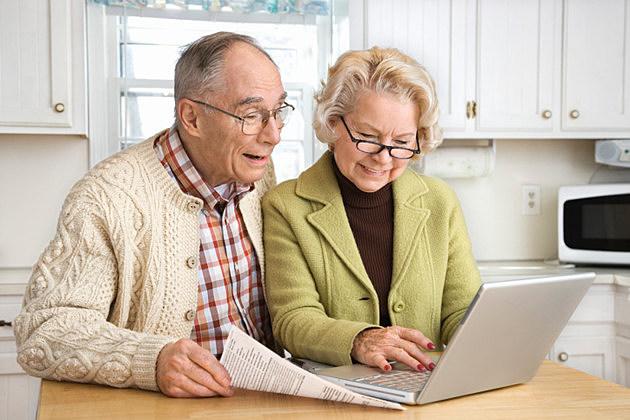 Senior couple working on laptop computer