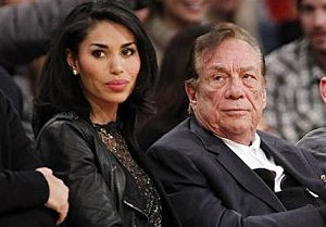 Los Angeles Clippers owner Donald Sterling, right, and V. Stiviano, left, watch the Clippers