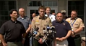 Brian Corvinus of the NJ Forest Fire Service is surrounded by Ocean County officials at a press conference
