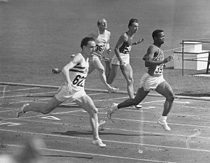 Peter Radford crosses the finish line to win his first heat in the 100 metres beating Frank Budd by a whisker with E. Ozolin in third place at the 1960 Olympic games in Rome.