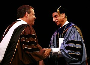 Governor Chris Christie shakes hands with President Ali Houshmand at the end of Rowan University Undergraduate Commencement Ceremony