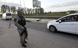 The vigilantes carry out a security on the check point in Boryspil outside Kiev, Ukraine