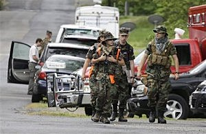 Search teams arrives at a command post for the recovery efforts from a hot air balloon accident in Ruther Glen, Va.