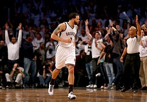 Deron Williams #8 of the Brooklyn Nets celebrates his three point shot