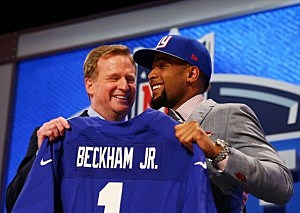 Odell Beckham Jr of the LSU Tigers poses with NFL Commissioner Roger Goodell after he was picked #12 overall by the New York Giants during the first round of the 2014 NFL Draft