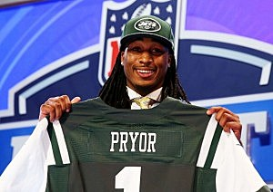 Calvin Pryor of the Louisville Cardinals poses with a jersey after he was picked #18 overall by the New York Jets during the first round of the 2014 NFL Draft