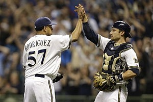 Francisco Rodriguez #57 of the Milwaukee Brewers celebrates with Jonathan Lucroy #20 after the 5-4 win over the New York Yankees