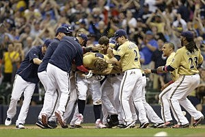 Mark Reynolds #7 of the Milwaukee Brewers celebrates with his team after hitting a walk off single in the bottom of the ninth inning against the New York Yankees