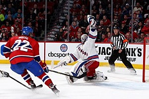 Goaltender Henrik Lundqvist #30 of the New York Rangers makes a glove save