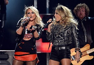 Miranda Lambert (L) and Carrie Underwood perform onstage during the 2014 Billboard Music Awards