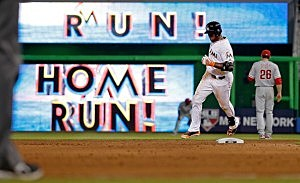 Marcell Ozuna #13 of the Miami Marlins rounds second base after hitting a grand slam