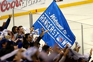 Fans cheer on the New York Rangers