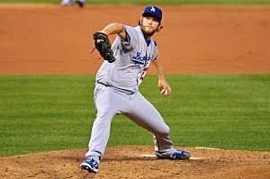 : Starting pitcher Clayton Kershaw #22 of the Los Angeles Dodgers delivers a pitch in the third inning against the Philadelphia Phillies