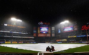 The tarp covers the field at Citi Field (