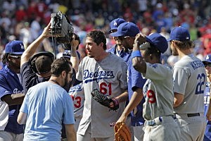 Josh Beckett #61 of the Los Angeles Dodgers celebrates with teammates after  throwing a no hitter during a game against the Philadelphia Phillies