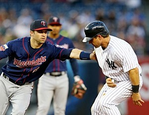 Brian Dozier #2 of the Minnesota Twins tags out Brian Roberts #14 of the New York Yankees