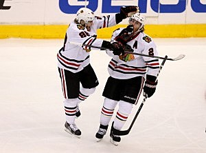 Duncan Keith #2 of the Chicago Blackhawks celebrates with Patrick Kane #88