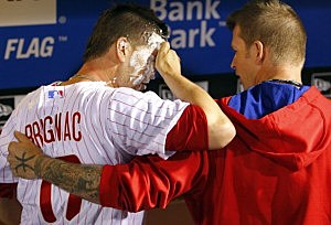 Reid Brignac #17of the Philadelphia Phillies is hugged by teammate A.J. Burnett #34 who hit him with a towel full of shaving cream after Brignac hit the game winning single in the fourteenth inning