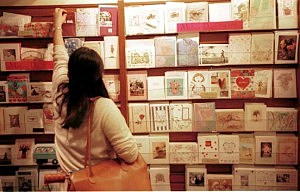 Cards buyers look over Mother's day cards