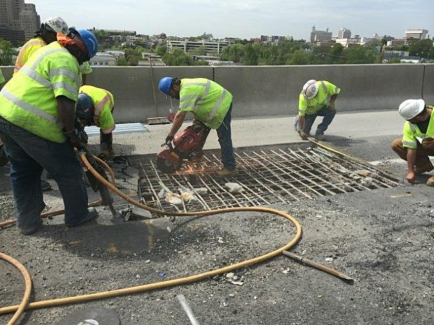 Crews work to repair a hole on the New Jersey Turnpike's Newark Bay-Hudson County Extension