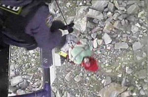 NYPD hoists an injured  woman off the rocks along the Hudson River in Alpine