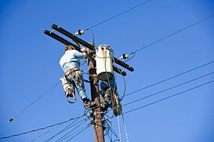 Electrician on utility pole