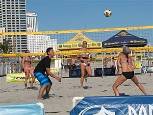 Beachgoers play volleyball on the Atlantic City beachfront before a national pro volleyball tour began.