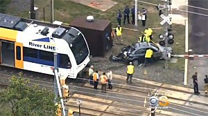 NJ Transit light rail train and car afte colliding in Cinnaminson