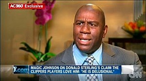 Magic Johnson talks with host Anderson Cooper