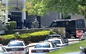 Police officers enter WMAR-TV, after a truck driven by a man rammed the Baltimore-area television station