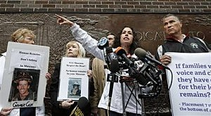 Rosaleen Tallon, sister of firefighter Sean Tallon, killed in the 9-11 World Trade Center attacks and other 9-11 victims' family members hold a press conference in front of a fire station opposite the National September 11 Memorial & Museum in New York,